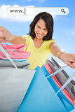 Woman showing her shopping bags under address bar