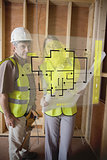 Architect and foreman checking the plans on interface