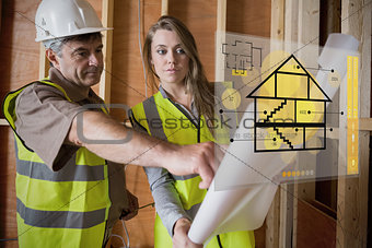 Architect and foreman consulting the plans on interface