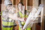 Architect and foreman looking at the plans on interface