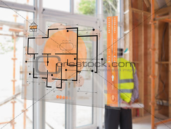 Architect looking out window with hologram interface in foreground