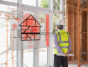 Architect looking out window with red hologram interface in foreground
