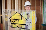 Architect standing behind house plan interface