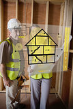 Architect and foreman standing behind house plan interface