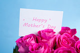 Bouquet of pink roses with mothers day card