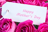 Closeup of a bouquet of pink roses with happy mothers day card in pink