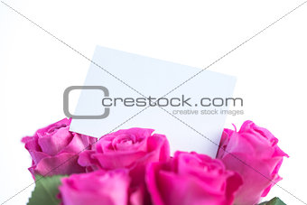 Beautiful bouquet of roses with an empty card