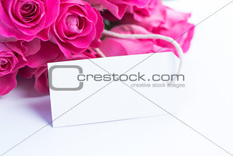 Close up of a beautiful bouquet of roses with a blank card