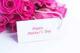 Close up of a beautiful bouquet of pink roses with a happy mothers day card