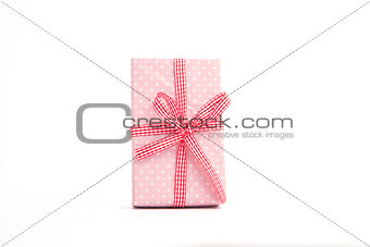 Pink gift on a white background
