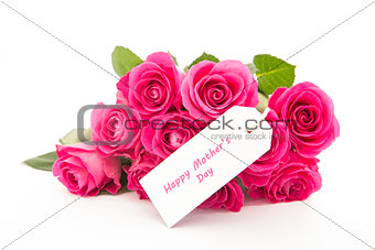 Close up of a beautiful bouquet of pink roses with a happy mothers day card on a white background
