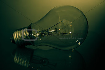 Clear light bulb in green light