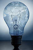 Close up of big light bulb standing with earths surface in it