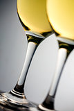 Close up of two white glasses full of white wine