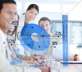 Business people using blue pie chart futuristic interface