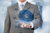 Businessman using blue pie chart futuristic interface