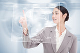 Businesswoman using nice transparent futuristic interface