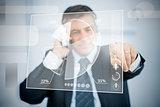Businessman using transparent pie chart interface