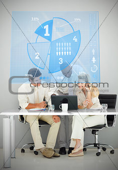 Three business people using blue pie chart interface