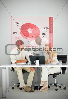 Three business people using red pie chart interface