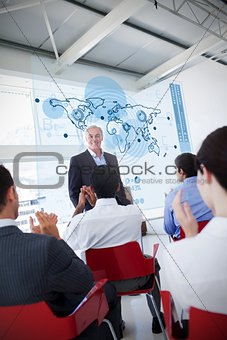 Business people clapping stakeholder standing in front of map diagram interface