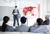 Business people listening and looking at red map diagram interface