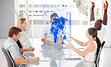 Cheerful business workers using blue map diagram interface