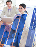 Overview of cheerful colleagues looking at blue chart futuristic interface