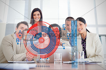 Smiling business workers looking at chart interface