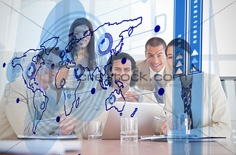 Smiling business workers looking at blue map interface