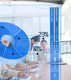 Serious business people using blue pie chart interface