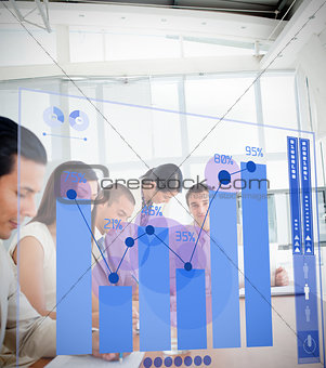 Group of colleagues using blue chart interface