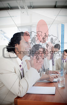 Happy businessman looking at futuristic red map interface