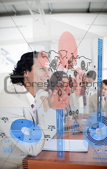 Group of colleagues using futuristic chart interfaces