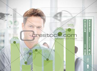 Businessman looking at green chart interface