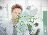 Businessman looking at green map interface