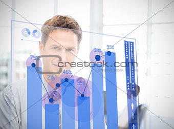 Businessman looking at blue chart interface