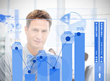 Businessman looking at blue futuristic diagram interface