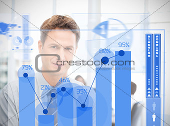 Businessman looking at blue futuristic diagram interface