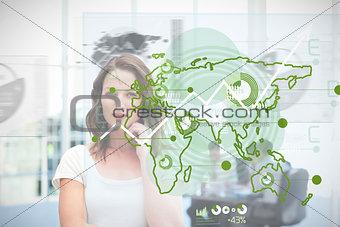 Blonde businesswoman using green map interface