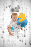 Jigsaw pieces floating around a cute baby playing with a blue planet