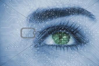 Close up of woman eye analyzing circuit board