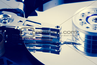 Close up of hard disk drive in blue tint