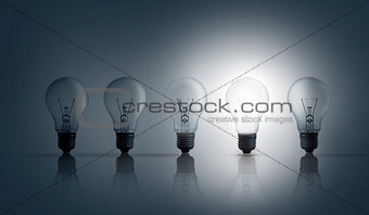 Five light bulbs in row