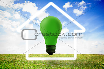 Green light bulb with white house outline