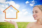 Smiling woman looking at house outline
