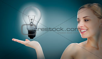 Big light bulb lighting inside hand