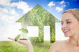 Seedling growing in womans hand