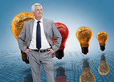 Businessman in front of colored light bulbs