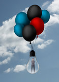 Businesswoman inside light bulb held by balloons